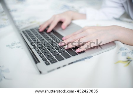 Slender fingers of her  on the keyboard
