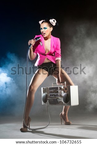 Slender girl singer with a tape recorder