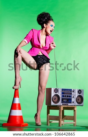 Slender girl with a tape recorder - stock photo