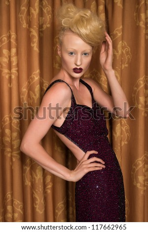 Slender pale blonde in a purple gown