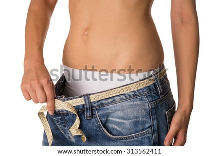 slender woman with a too large pants / slender woman - stock photo