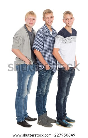 Slender young men eighteen years in full llength. Two of the boys twin brothers. - stock photo