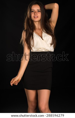 Slender young Romanian woman in a beige blouse and black skirt - stock photo