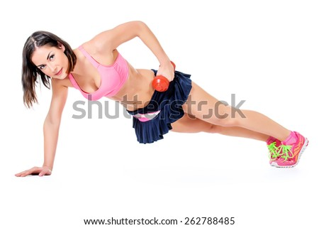 Slender young woman with beautiful athletic body pushed from the floor with the dumbbell. Fitness, bodybuilding. Health care. Isolated over white. - stock photo