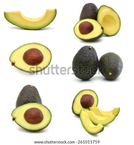 Slice and whole of avocado on white background  - stock photo