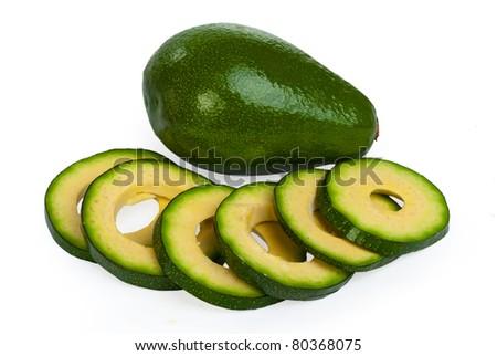 Slice avocado on white background - stock photo