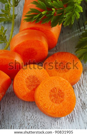 slice carrot on wooden background - stock photo