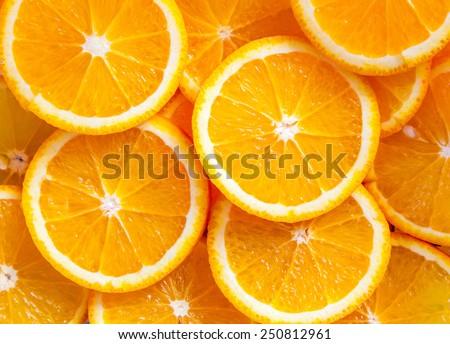 Slice fresh orange fruit background - stock photo