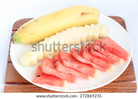 slice fruits (bananas and watermelon) put on plate