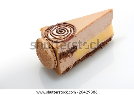 Slice of a cake with the French cookies on acrylic glass. - stock photo