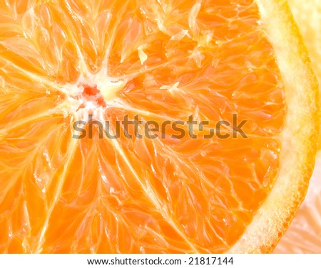 Slice of a fresh juicy orange close up.