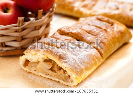 slice of an apple strudel on the table - stock photo