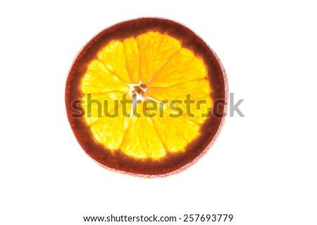 Slice of an orange  isolated on white background back lit - stock photo