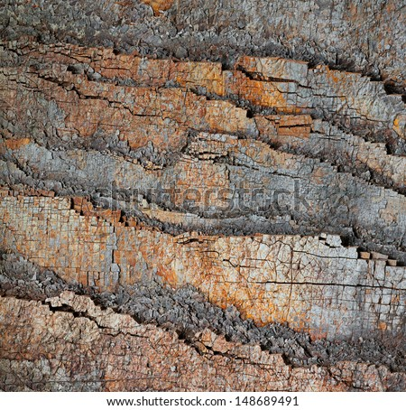 Slice of ancient stone rocks - geological natural background - stock photo