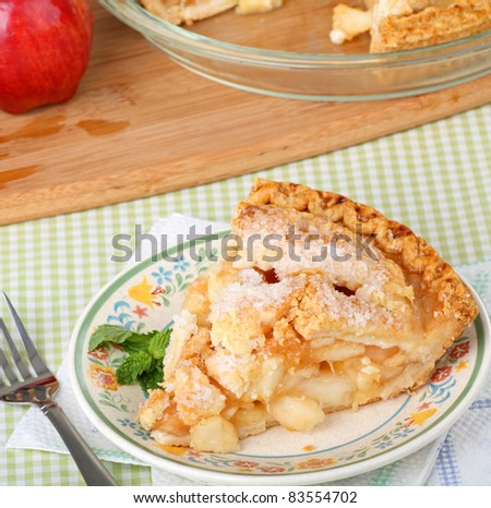 Slice of apple pie on a plate - stock photo