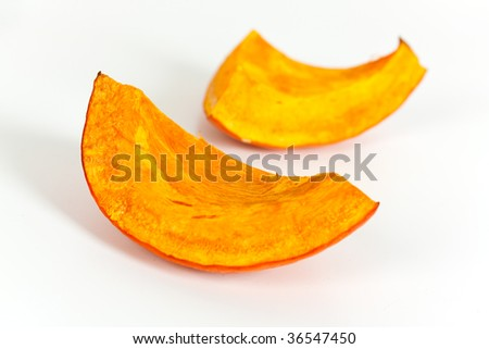 Slice of baked pumpkin isolated on white background - stock photo