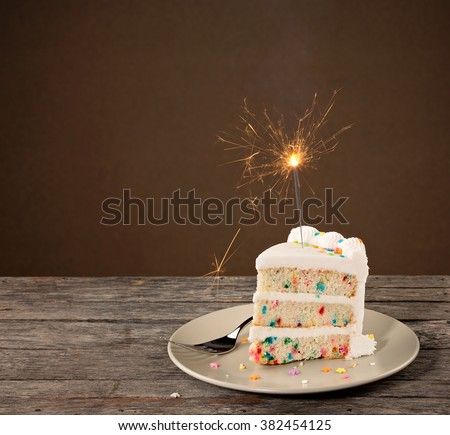 Slice of Birthday Cake with sparkler - stock photo
