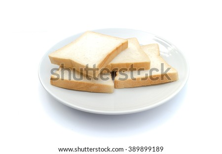 Slice of bread on dish with white background