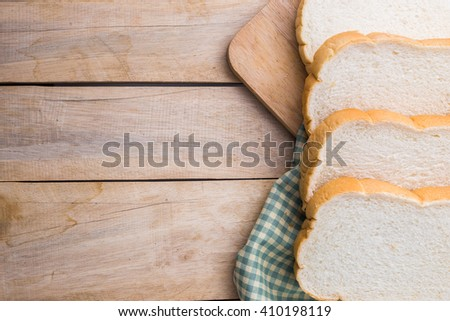slice of bread on wooden table - stock photo