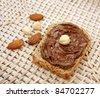 Slice of bread with chocolate cream - stock photo