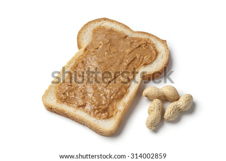Slice of bread with peanut butter on white background - stock photo