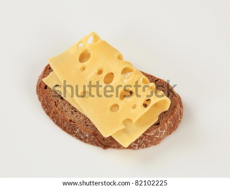 Slice of brown bread and Swiss cheese  - stock photo