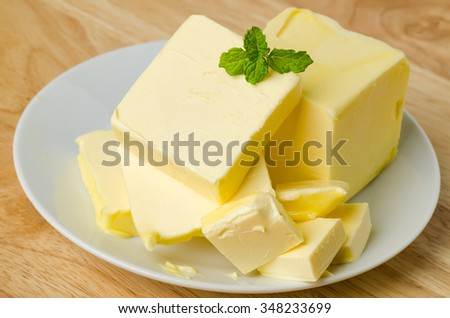 Slice of butter for baking or cooking - stock photo