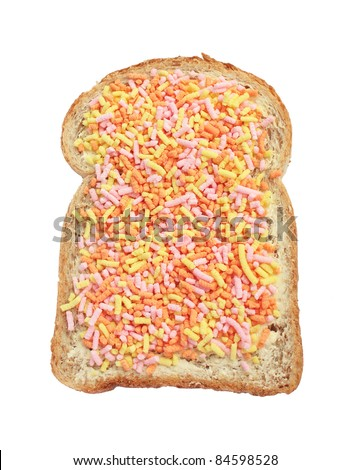 "Slice of buttered brown bread with Dutch fruit sprinkles, called ""vruchtenhagelslag"". - stock photo"