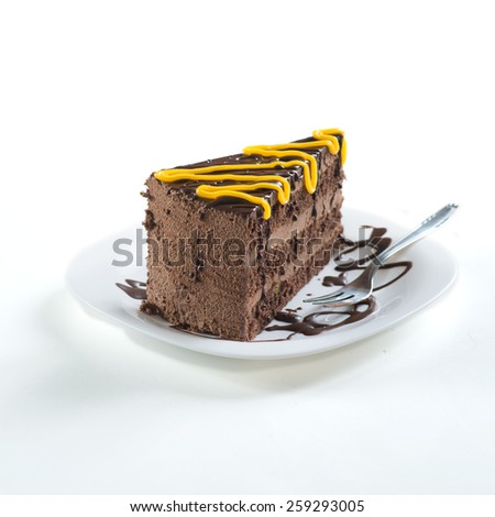 Slice of  cake on plate ready for eating - stock photo