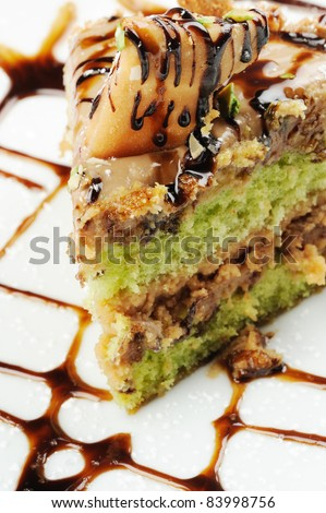 slice of cake with chocolate and pistachio - stock photo