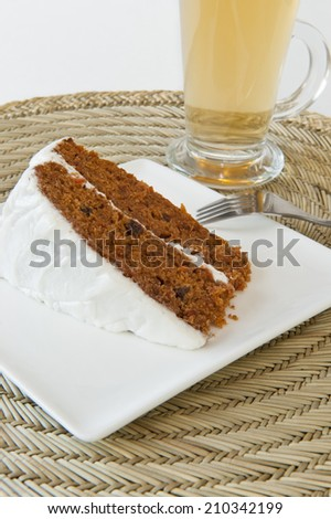 Slice of carrot cake with a cup of tea - stock photo