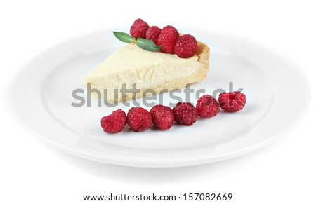 Slice of cheesecake with raspberry on plate, isolated on white - stock photo