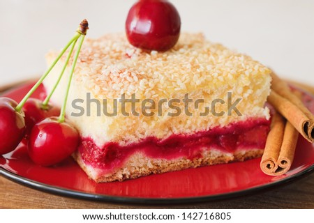 Slice of cherry pie on a plate