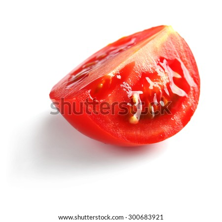 Slice of cherry tomato isolated on white - stock photo