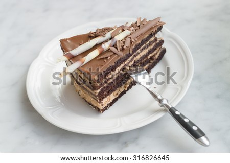 Slice of chocolate cake on plate with fork, selective focus - stock ...