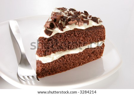 Slice of chocolate cake stuffed with whipped cream, covered with whipped cream and white chocolate on neutral background - stock photo