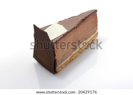Slice of chocolate cake with nuts on acrylic glass. - stock photo