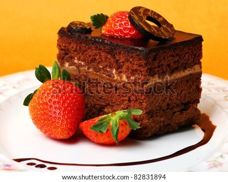 Slice of chocolate cake with strawberries. - stock photo