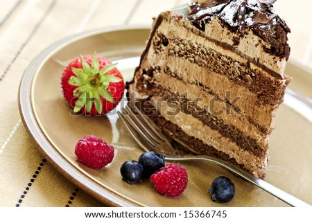 Slice of chocolate mousse cake served on a plate - stock photo