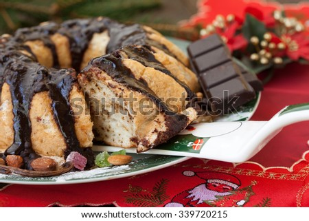Slice of Christmas cake decorated with chocolate - stock photo