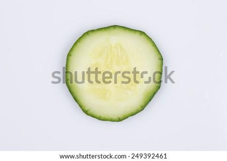 slice of cucumber isolated on white background - stock photo