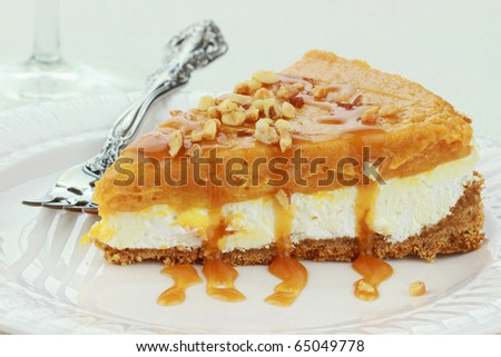 Slice of Double Layer No Bake Pumpkin Pie made with pumpkin, vanilla pudding,and cream cheese ready for Thanksgiving or Christmas dinner. - stock photo