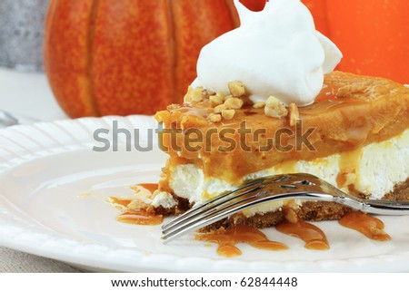 Slice of Double Layer No Bake Pumpkin Pie made with pumpkin, vanilla pudding,cream cheese, and whipped cream. - stock photo