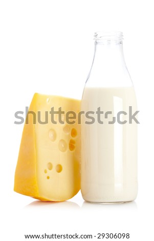 Slice of fresh cheese and milk bottle isolated on white background - stock photo