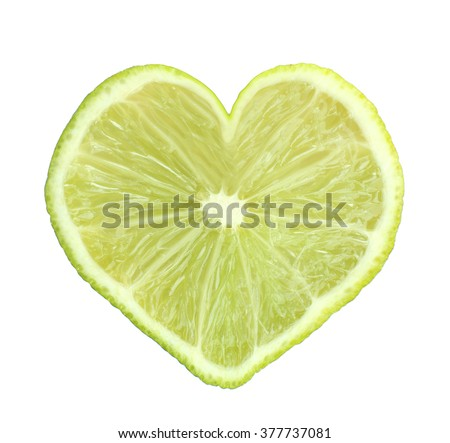 Slice of fresh lime in heart shape, isolated on white - stock photo