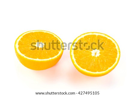 slice of fresh orange fruit that were cut in half on white background
