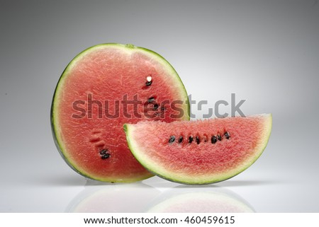 slice of fresh watermelon and juicy tomato on white background