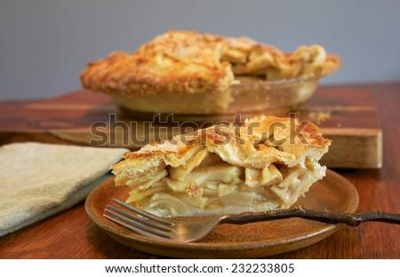 Slice of homemade apple pie for dessert - stock photo