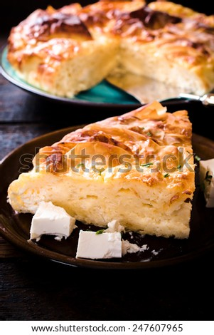 Slice of homemade Serbian traditional cheese pie,selective focus - stock photo