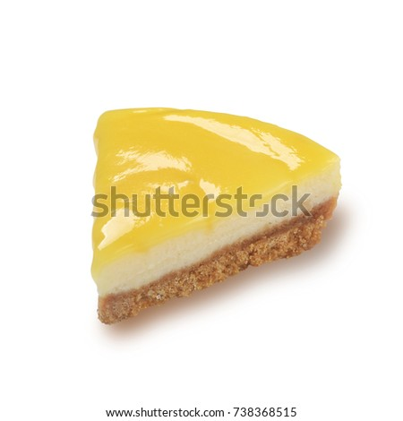 Slice of lemon cheesecake isolated on white